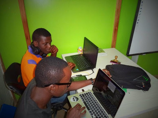 two men coding at bootcamp