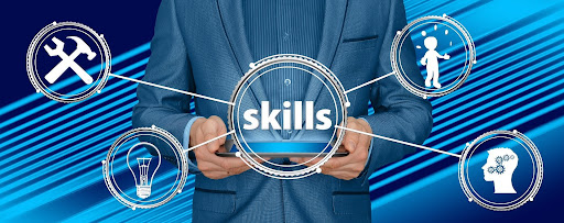 Person holding a graphic with the word skills.