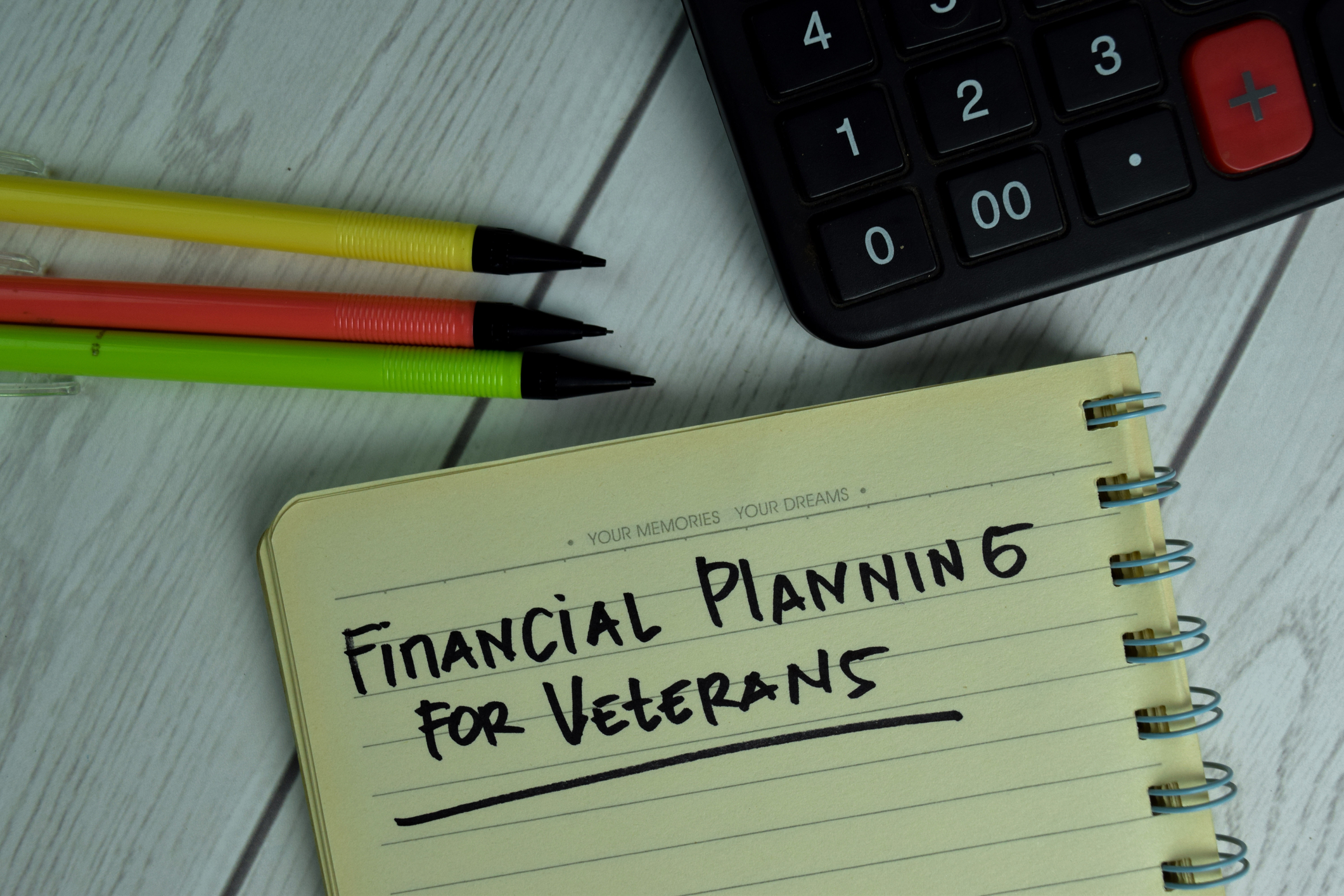 Notepad that says financial planning for veterans on table with calculator and three pencils Transition to a Tech Workforce