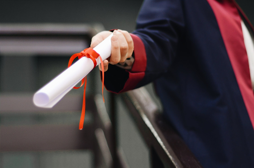 person holding diploma