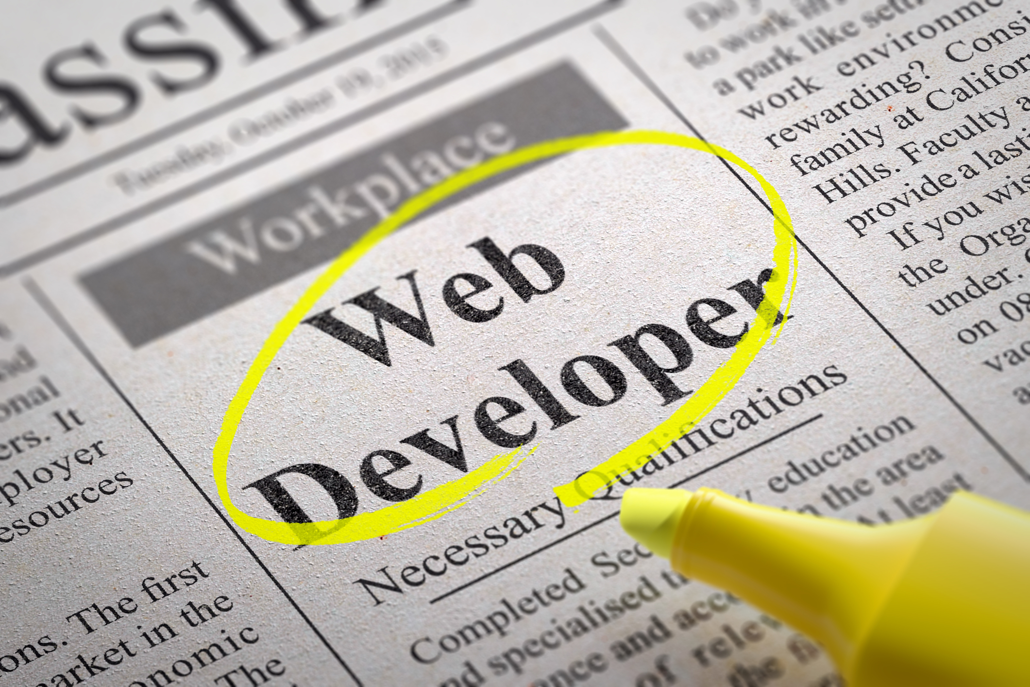 Newspaper Add Job listing for Web Developer Highlighted with Yellow Highlighter Job as a Web Developer