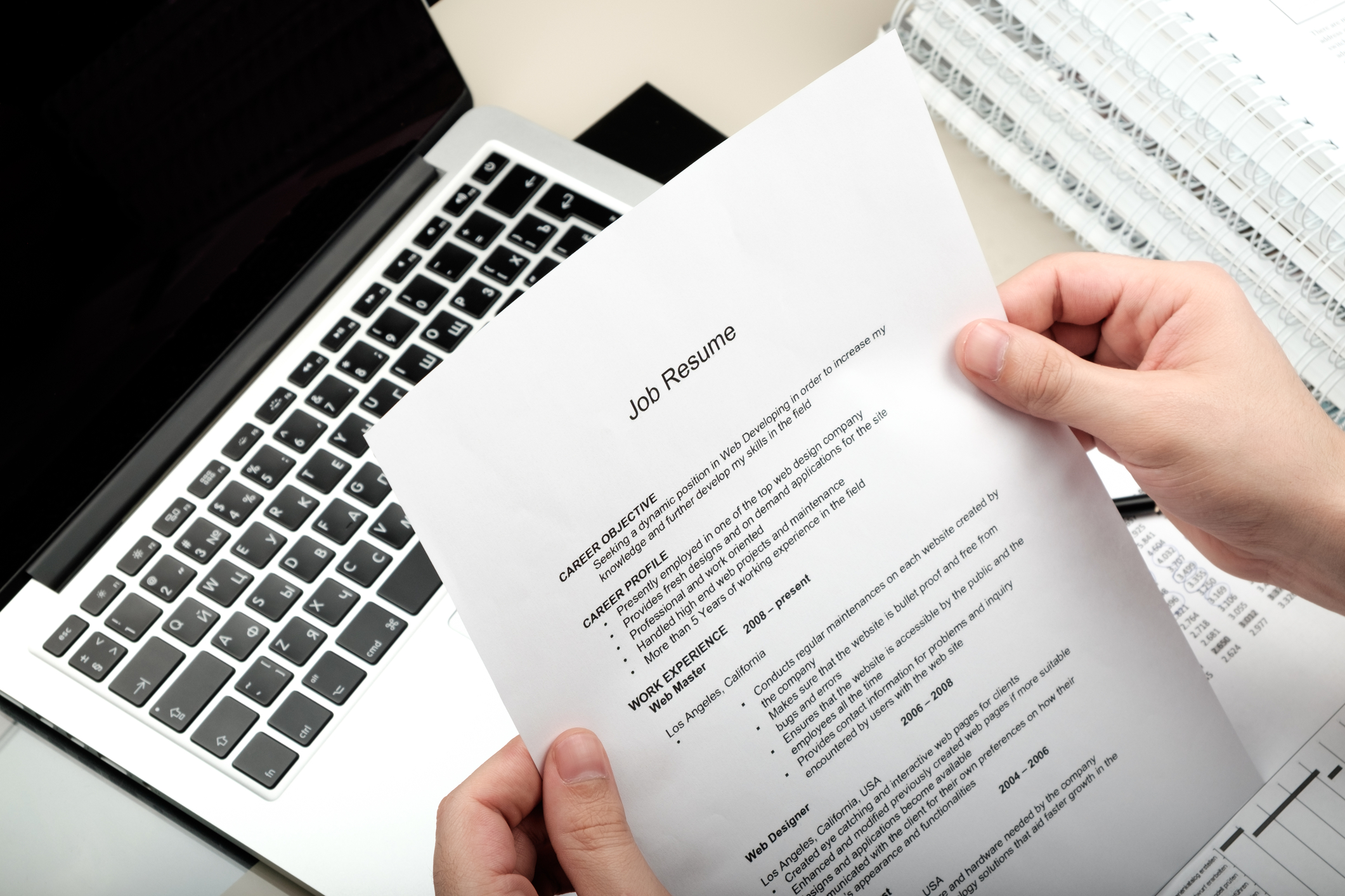 Resume Layout On Paper Above Laptop Software Engineering Career